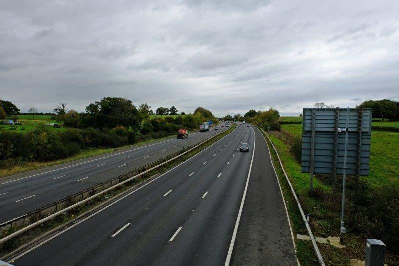 We cross the motorway
