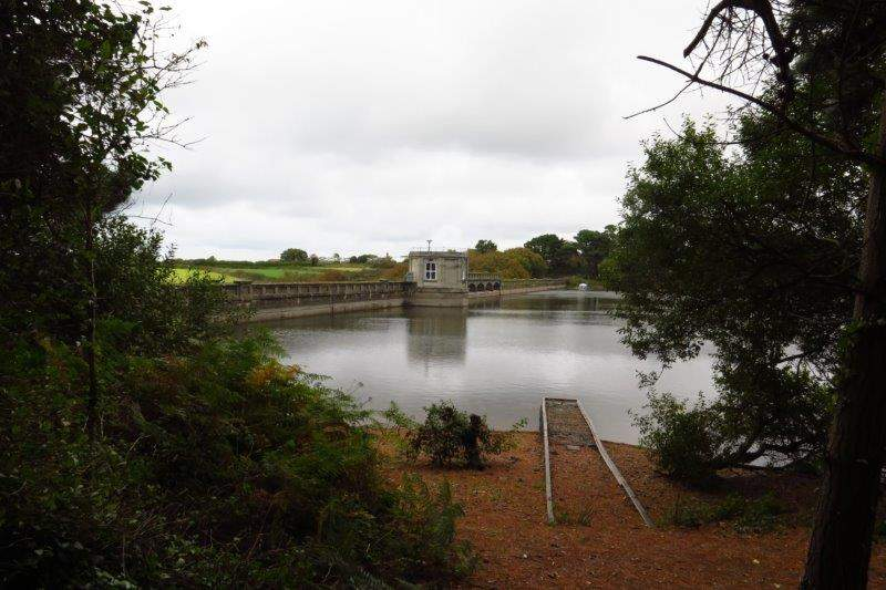 The dam at the head of the reservoir