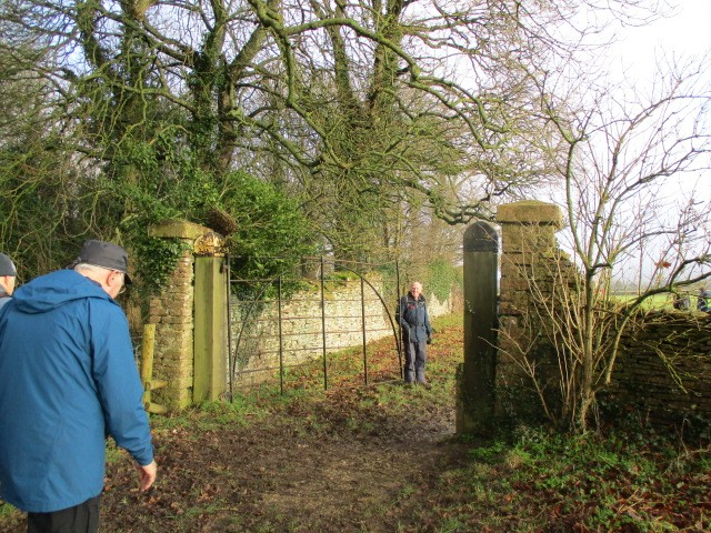 John opens the gate of his estate for us