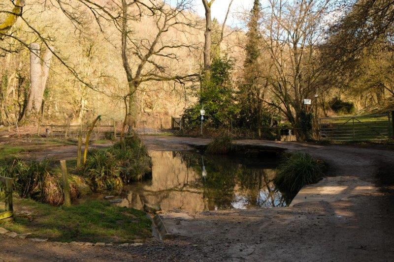 Crossing the stream on a narrow bridge