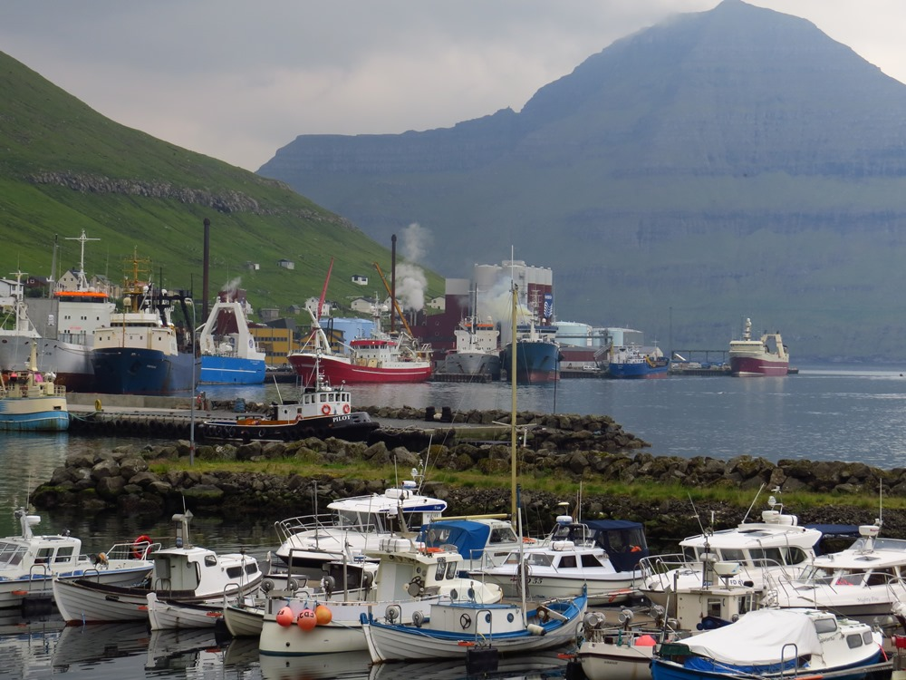 Fishing boats lined up along the waterfront in Fuglafjørður. Photo by ADT.