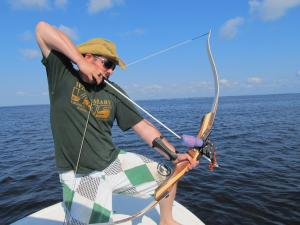 The author, bowfishing for cownose rays.