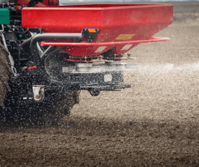 Tractor spreading fertiliser