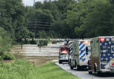 Hurricane Floodwaters Sweep Two Cars Off Street in Hughesville