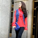 coming-out-of-a-building-red-blouse-with-blue-vest-and-leather-leggings