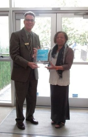 Dennis Creech accepts the EnergySTAR plaque from Karen Butler of the EPA.