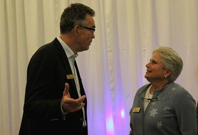 Dennis and outgoing board chair Linda Bolan share a joke at the Winter Solstice Celebration Wednesday evening.