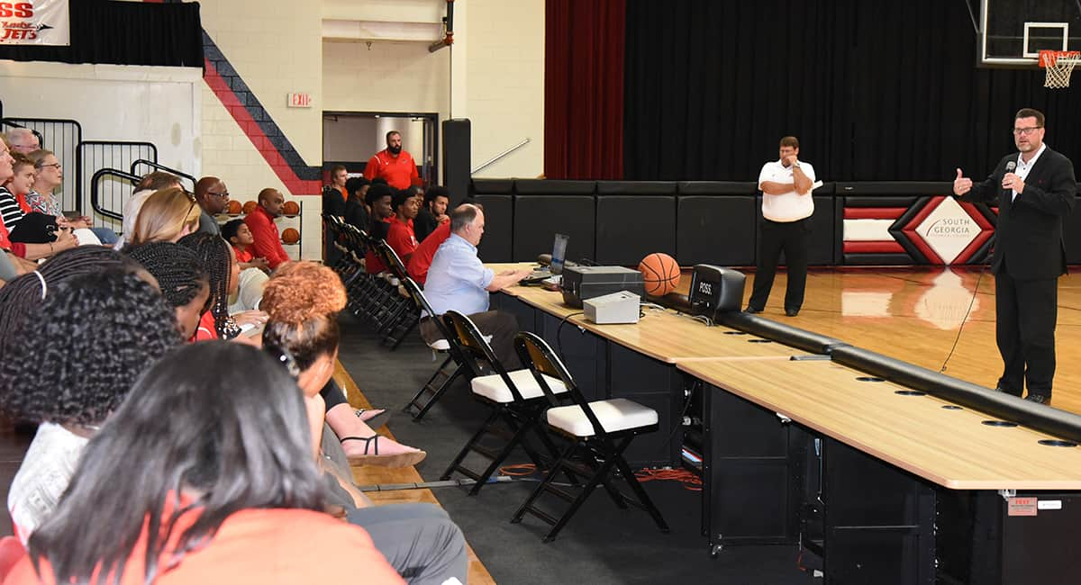 SGTC President Dr. John Watford is shown above welcoming individuals to the 2017 – 2018 Jets Kickoff event in the SGTC gymnasium.