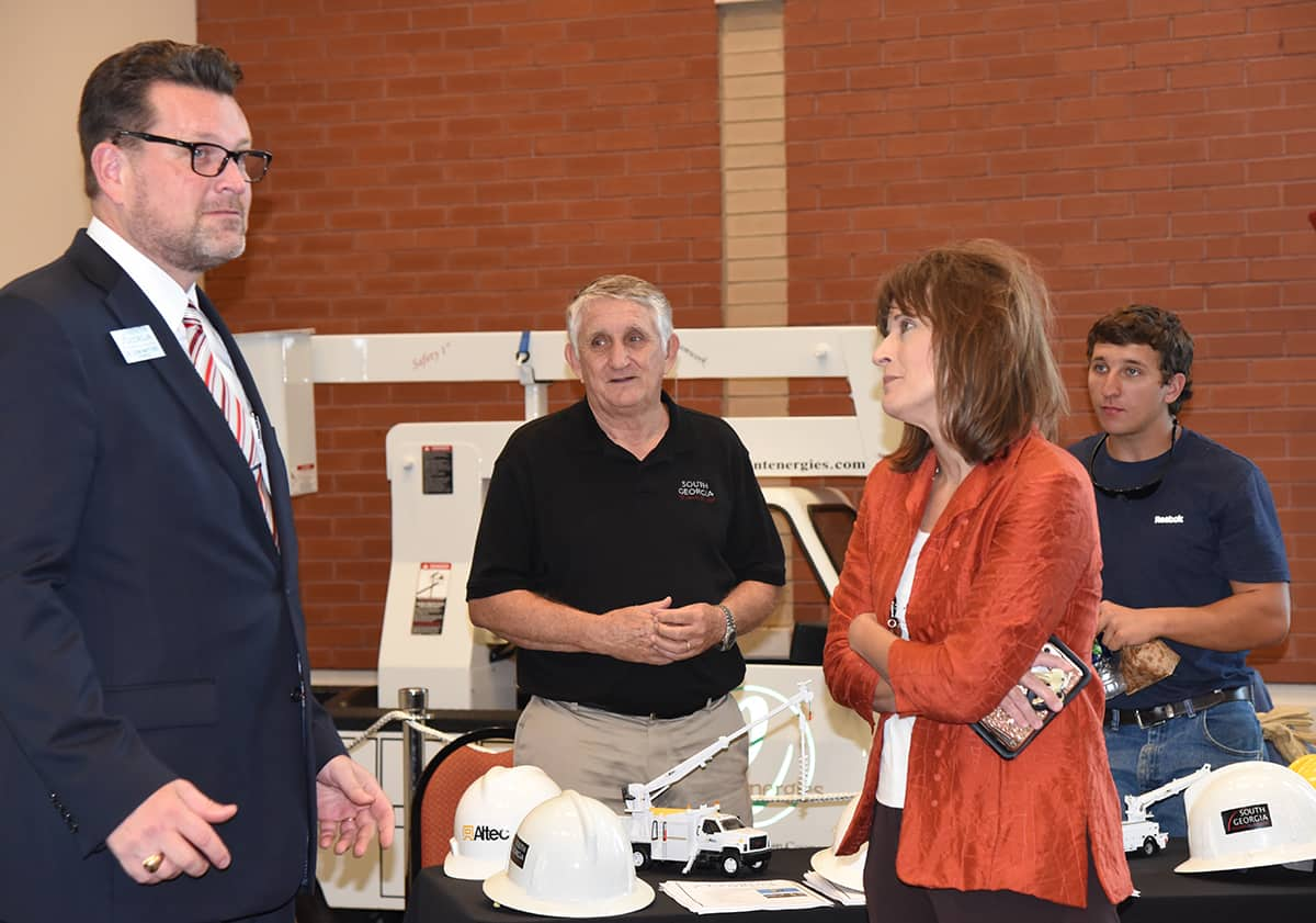 South Georgia Technical College President Dr. John Watford is shown above talking with Taylor County School Superintendent Jennifer Albritton about the college's Electrical Lineworker program.