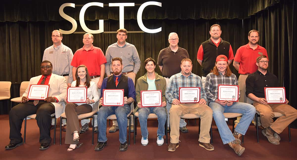 Seated from left to right are SGTC Student of Excellence nominees Shawn Tyson, Lacey Chandler, Charles Knoll, Charles Westra, Jason Fuller, Joel Barnes, and Joseph Woodham. Standing from left to right are nominating instructors Glynn Cobb, Mike Collins, Tyler Wells, Phil Deese, Chad Brown and Ted Eschmann.