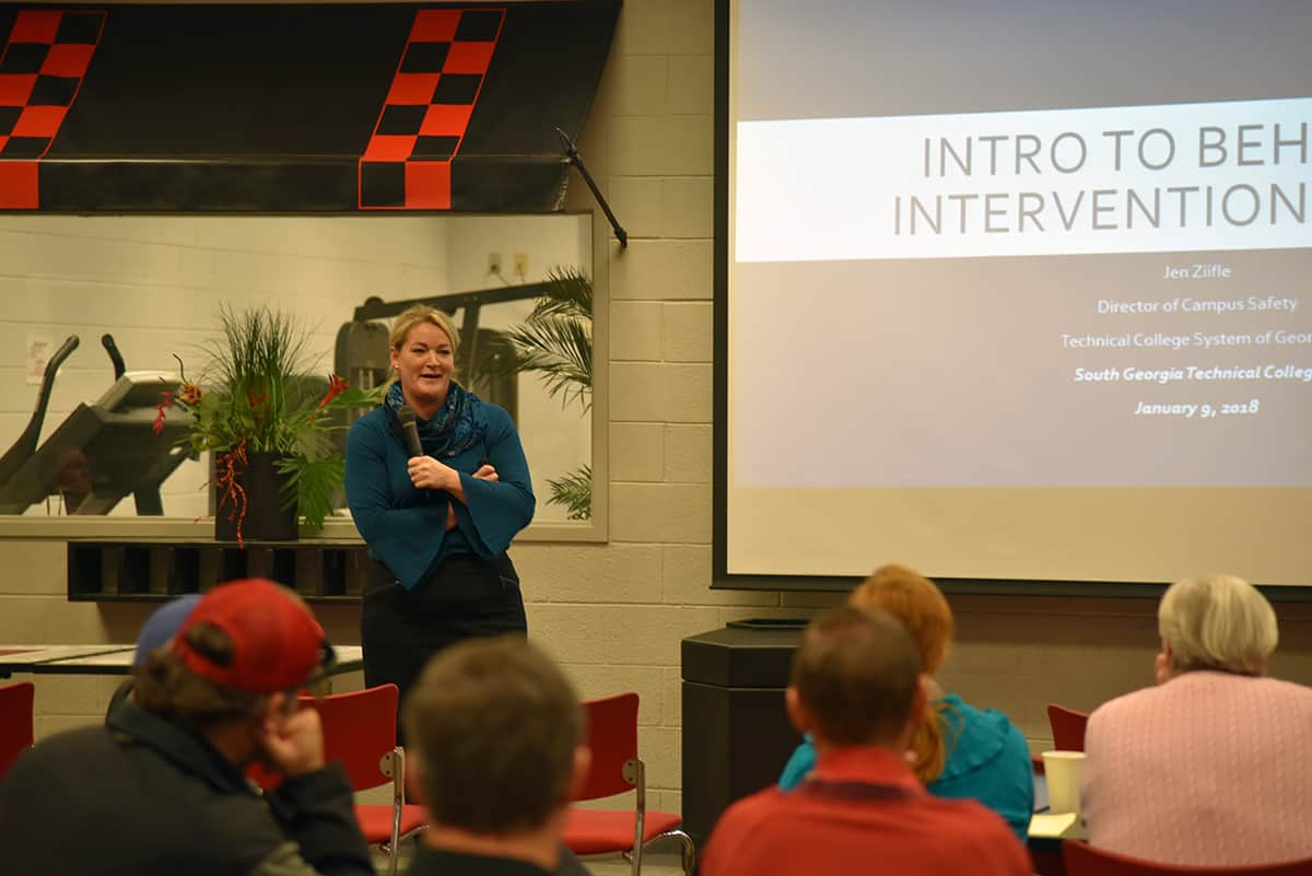 Technical College System of Georgia representative, Jen Ziifle, stands before SGTC employees to deliver a presentation on Behavioral Intervention Teams.