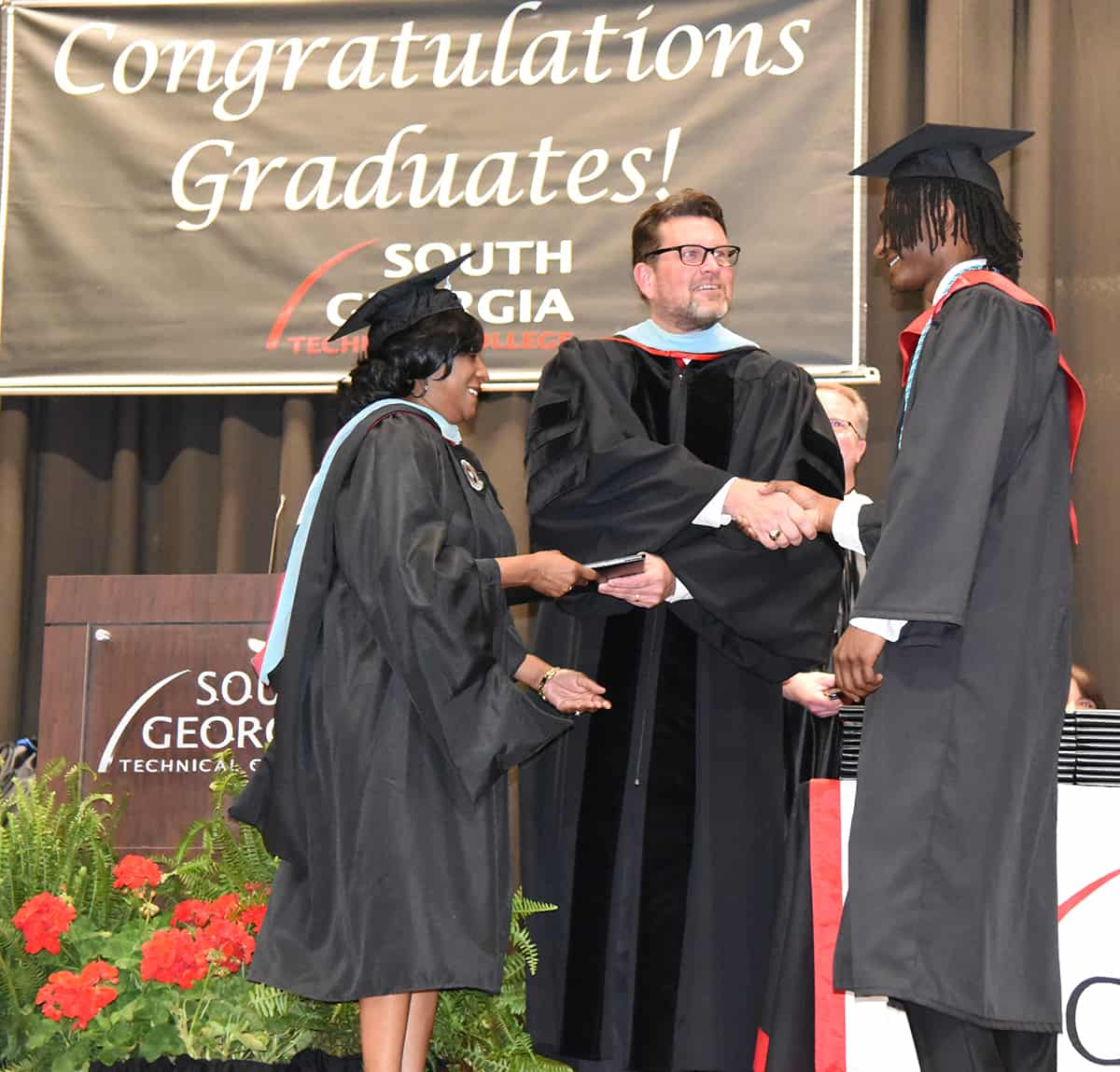 South Georgia Technical College's Deo Cochran was able to join SGTC President Dr. John Watford in awarding her son, Brandon Cochran with his associate of applied science degree at SGTC.  Brandon Cochran took advantage of the dual enrollment program and earn his associate degree before receiving his high school diploma.