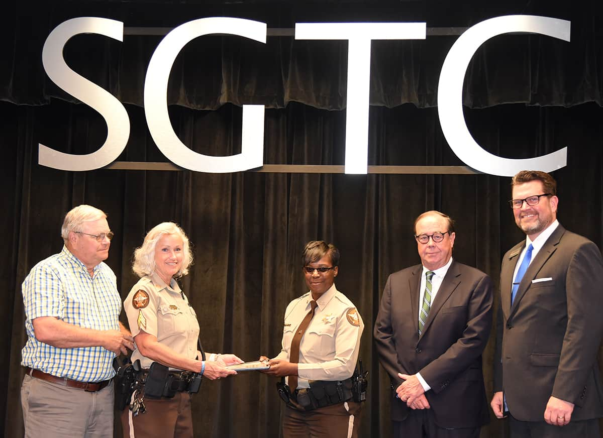 Paul and Sharon Smith Johnson are shown above presenting the Smarr-Smith Criminal Justice Scholarship to Sumter County Sheriff Deputy Antoinette Johnson as SGTC Foundation Trustee and retired Judge George Peagler, and SGTC President Dr. John Watford look on.
