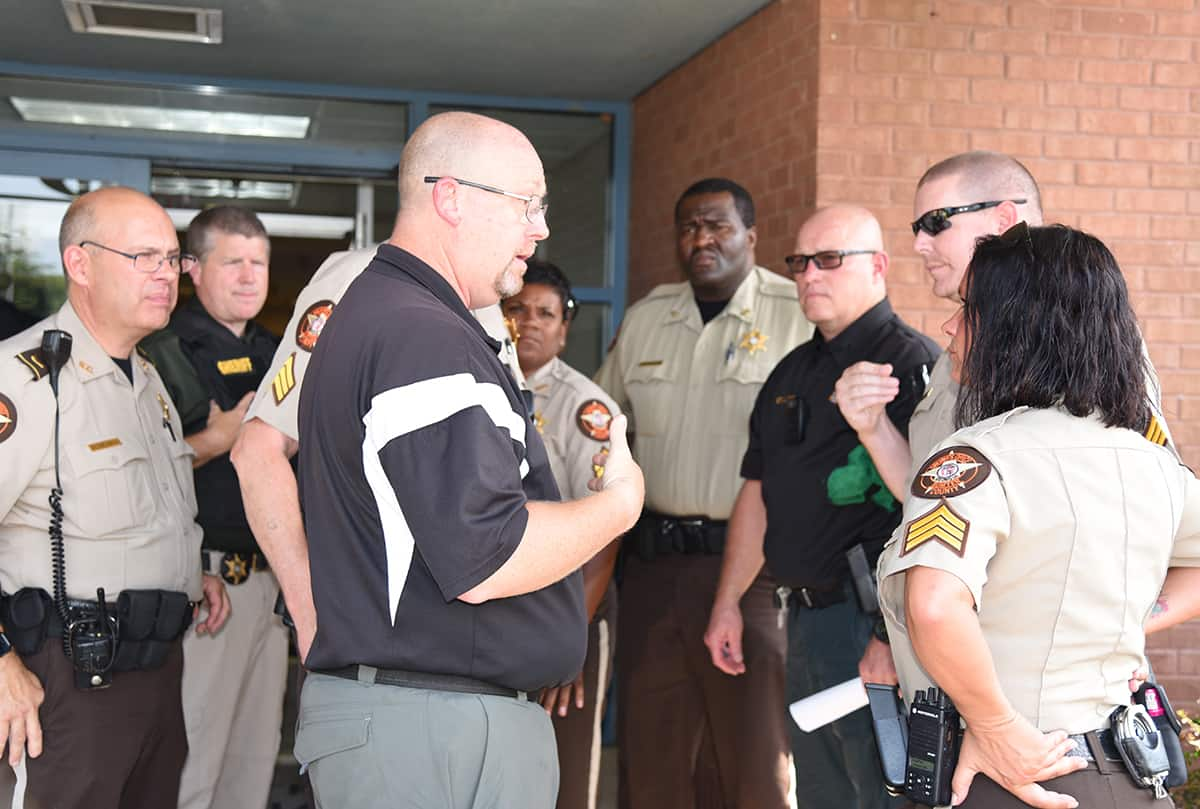 SGTC Law Enforcement Academy Director Brett Murray is shown above talking with different Law Enforcement agency individuals who would be assisting in the drill as evaluators.