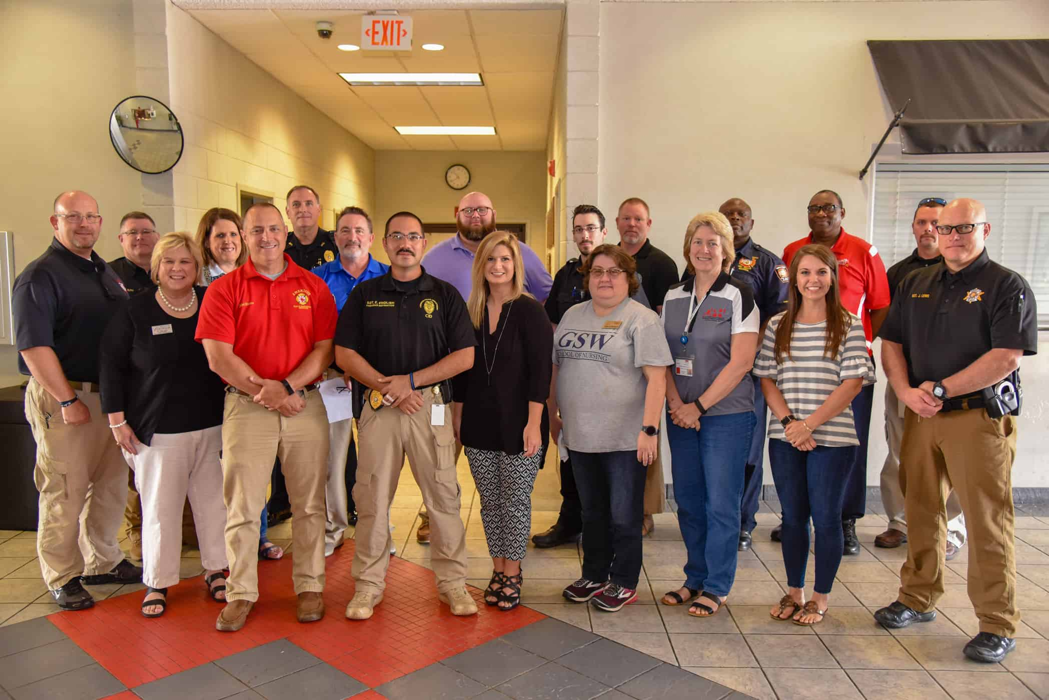 Representatives from participating agencies are shown together after a planning meeting for the upcoming emergency response training drill.