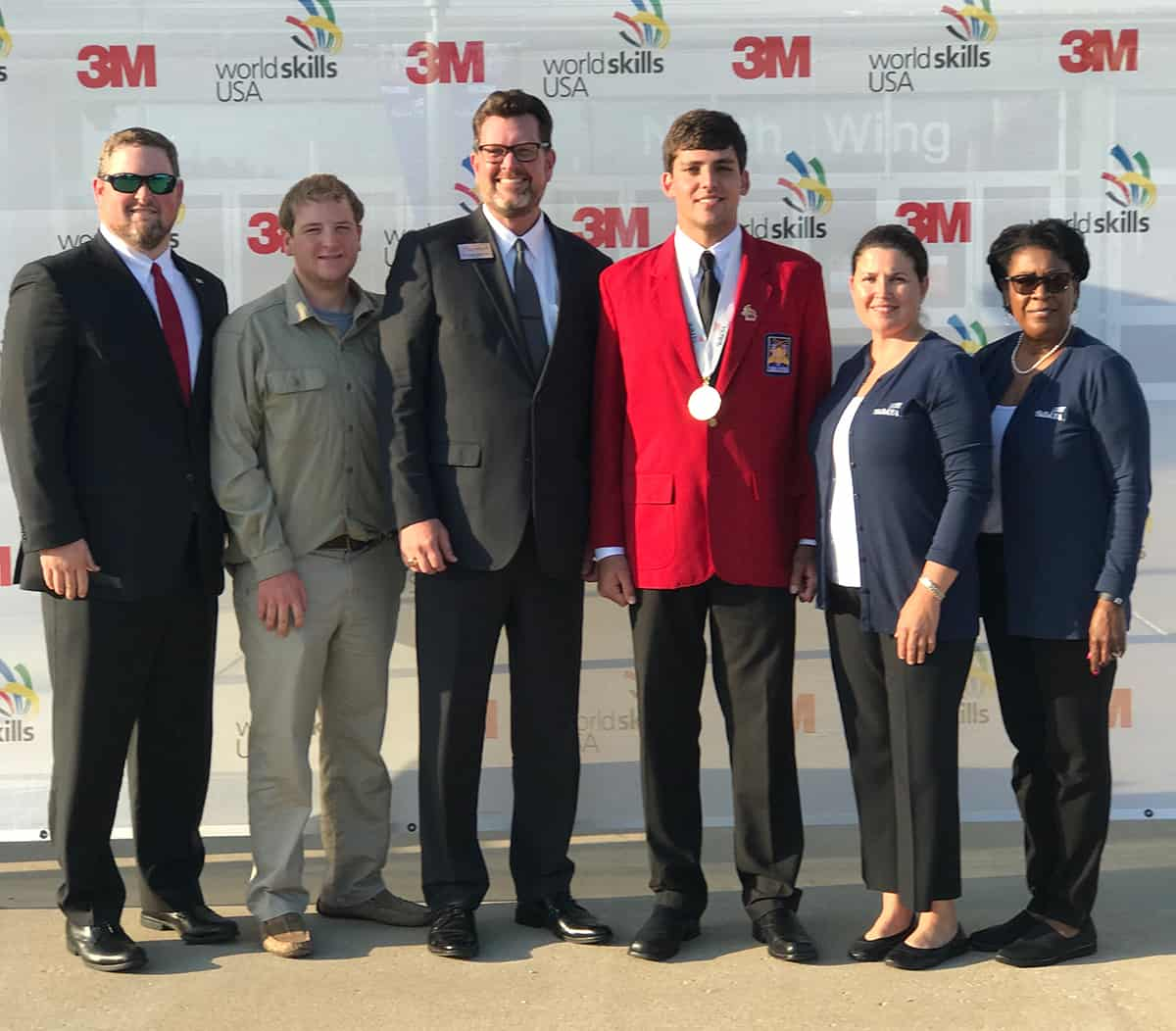 The South Georgia Technical College team stands together outside of the SkillsUSA Leadership and Skills Conference following the medal ceremony. Left to right: Chad Brown (advisor), Jacob Grant (student), SGTC President Dr. John Watford, Bailey Mills (student), Victoria Herron (advisor), Cynthia Carter (director, student organizations).