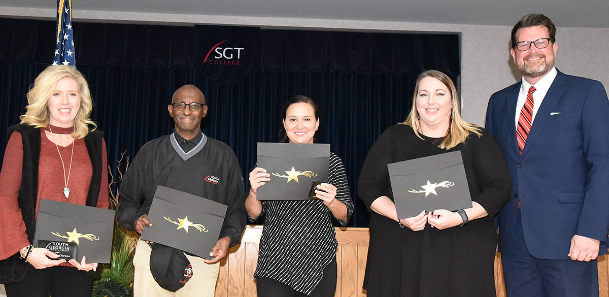 The SGTC Crisp County Center employees recognized for their years of service shown above are: (l to r) Teresa Jolly, Keith Lewis, Valerie Hines, and Kelly Everett.  SGTC President Dr. John Watford is shown congratulating them on their service.
