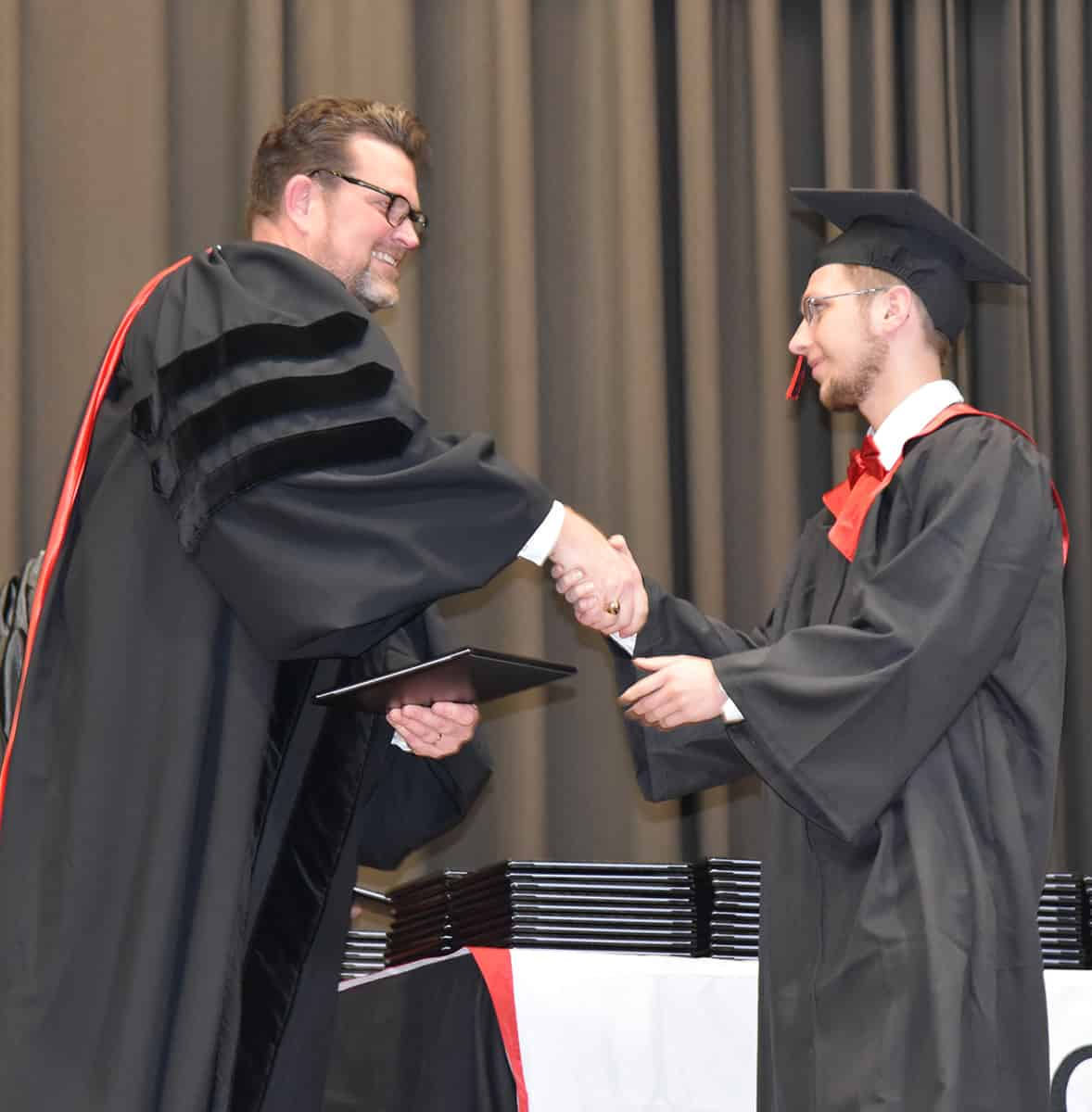South Georgia Technical College President Dr. John Watford is shown above (left) presenting a diploma to Levi Cowan of Americus who earned his Associate of Applied Science degree in Computer Support Specialist and Networking Specialist.  He has also been hired in the South Georgia Technical College IT department to work in his area of study.