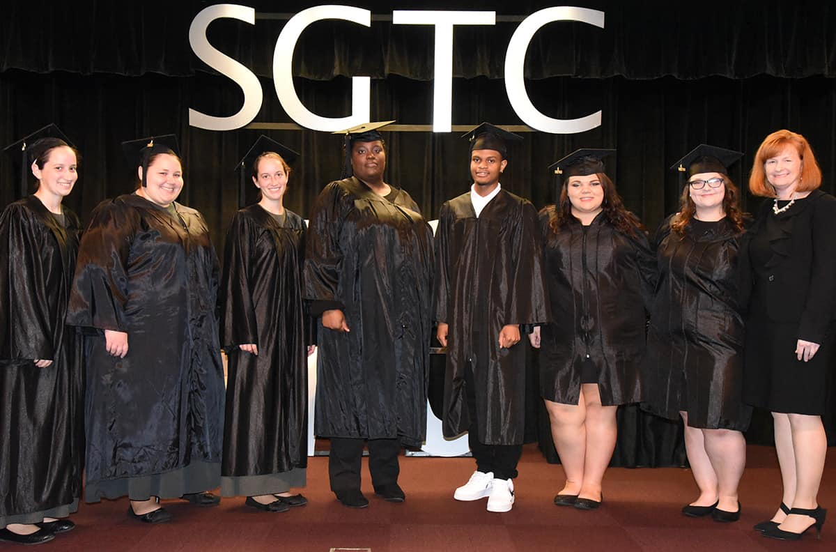 Macon County GED graduates are shown above with instructor Angie Kauffman.