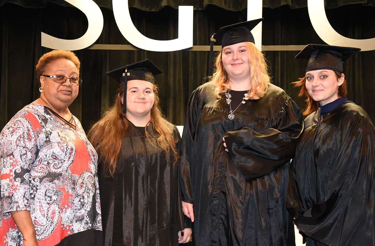 Mary King, GED Instructor is shown above with the Marion County GED graduates that walked at the ceremony.