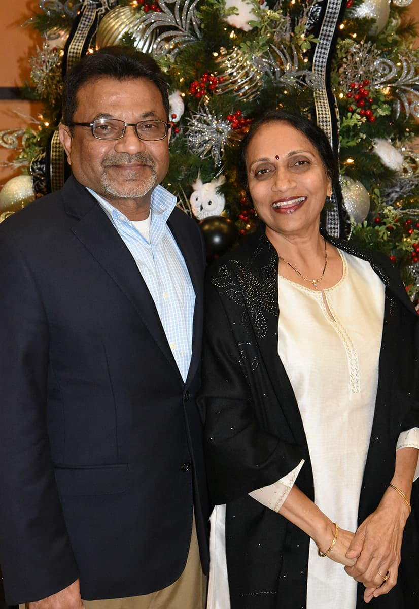 SGTC Foundation Vice Chairman Sharad Patel and his wife are shown enjoying the holiday celebration.