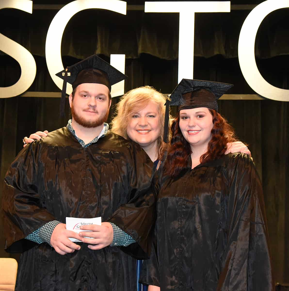 SGTC GED Instructor Alanna Goolsby is shown above with the Taylor County GED graduates.