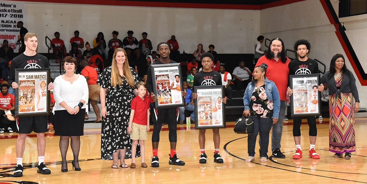 Jets sophomores with their family and friends.  Shown (l to r) are Jets Sam Matice, Jonathan Tchuisee, Durand Green and Adonis Green with their sophomore plaques.