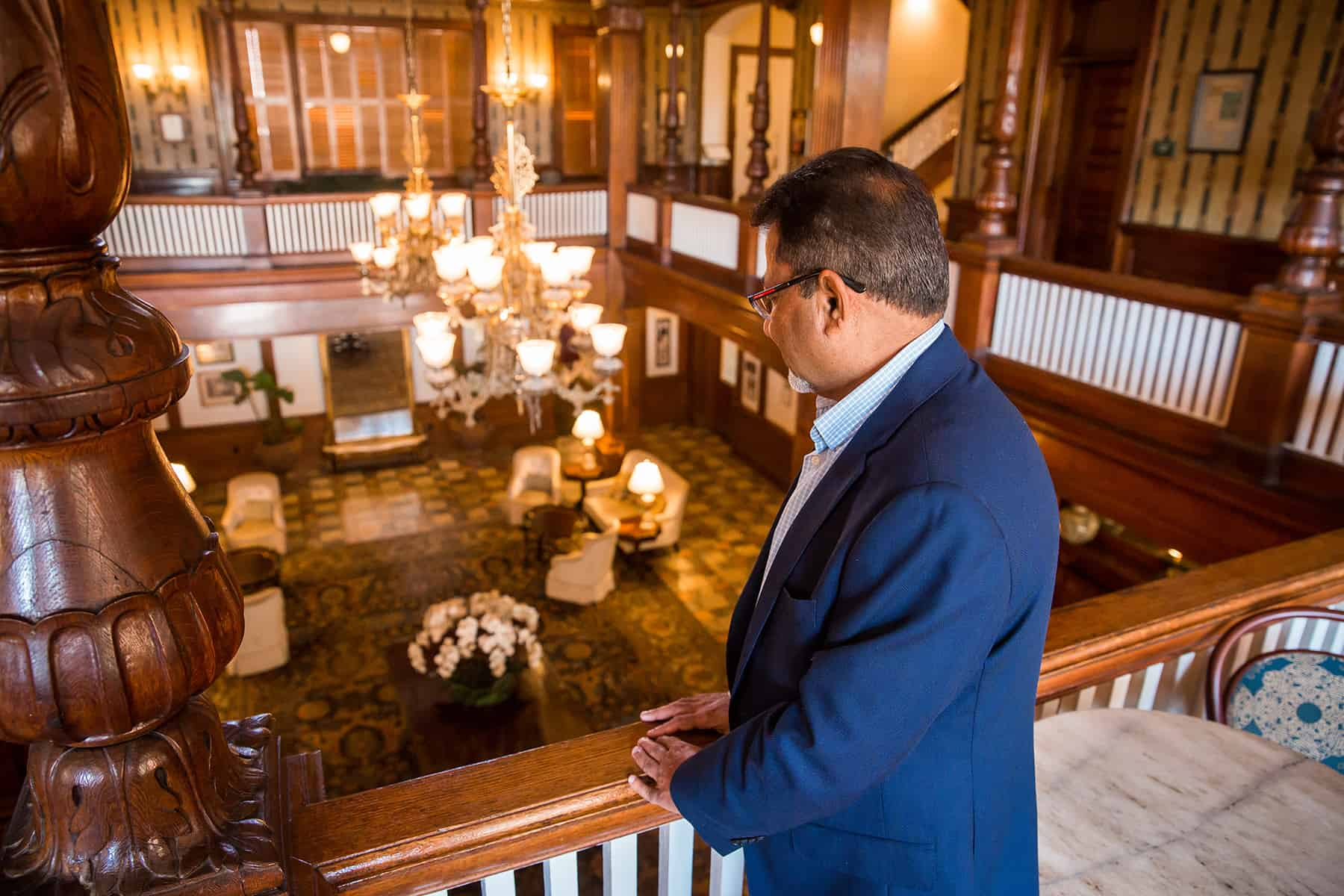 Sharad Patel looking down into the lobby of the Windsor Hotel.