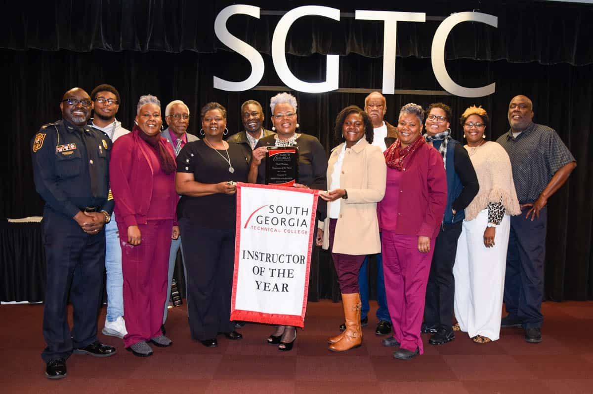 SGTC cosmetology instructor Dorothea Lusane McKenzie (center) is pictured with her family at a recent event to recognize her as the 2020 recipient of the Rick Perkins Instructor of the Year Award.