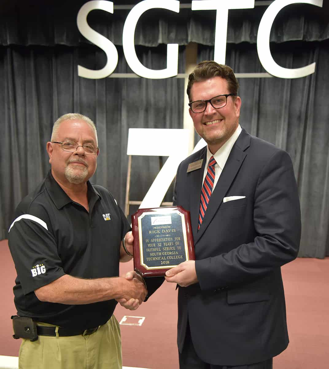 Dr. John Watford is shown above with Rick Davis when he retired from South Georgia Technical College.