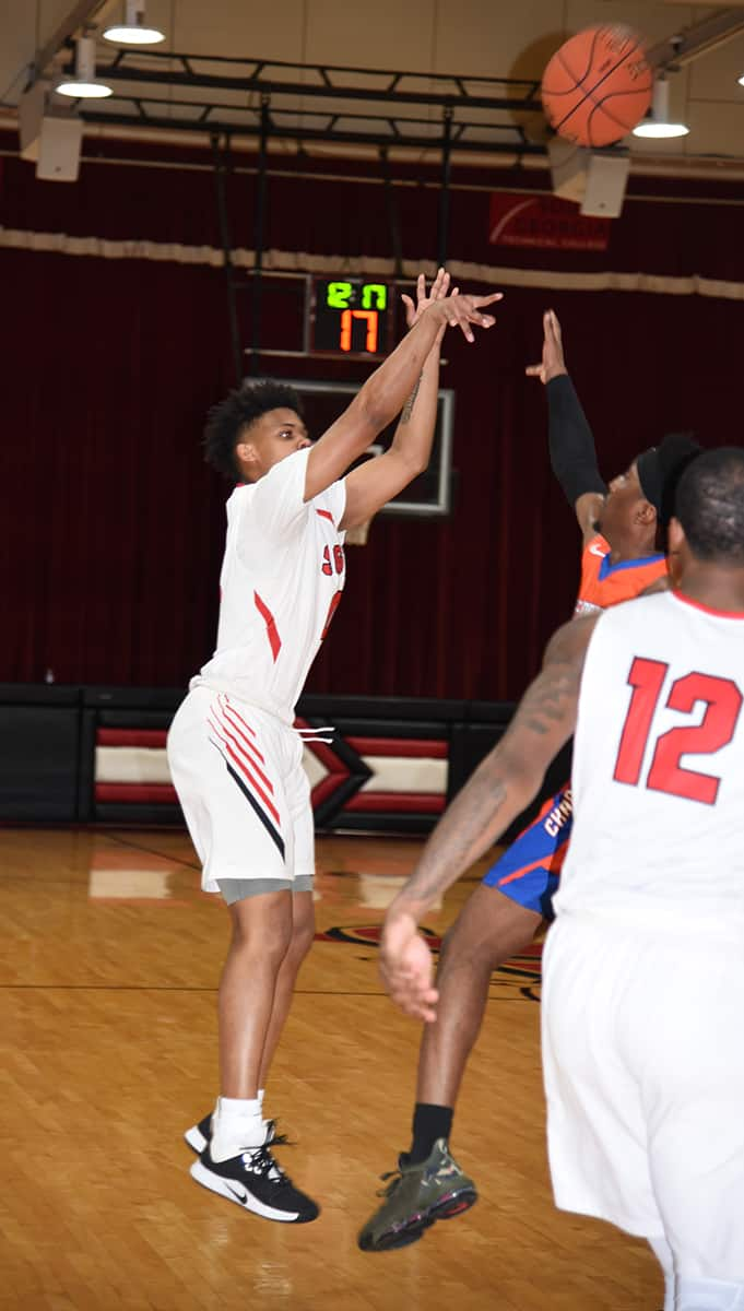 Toriano Lewis is shown shooting a three for South Georgia Technical College.