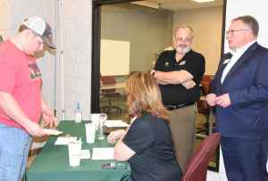SGTC Vice President of Academic Affairs David Kuipers is shown above talking with prospective students at the John Deere registration table.