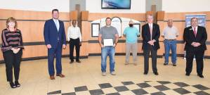 South Georgia Technical College President Dr. John Watford (second from left) is shown above presenting Louis Mahovetz with the Chattahoochee Flint RESA Electrical Lineworker Scholarship certificate. Also shown (l to r) are SGTC Economic Development Assistant Tami Blount, Dr. Watford SGTC Lineworker Instructor Sidney Johnson, Scholarship recipient Louis Mahovetz, Lineworker instructor Bobby Baxley, Chattahoochee Flint RESA Director Richard McCorkle, Electrical Lineworker instructor Dewey Turner and SGTC Economic Development Director Paul Farr.