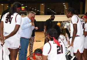 SGTC Lady Jets head coach James Frey is shown above talking with his team during time out.