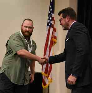 Dr. Watford is shown shaking hands with the Aviation Maintenance Gold Medal SkillsUSA winner, Jonathan Camp.