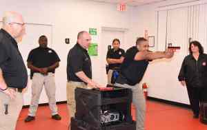 South Georgia Technical College Law Enforcement Academy Director Brett Murray is shown above (l to r) with LEA cadet Richard Franklin, Firearms Trainer Lt. Tony Bobbitt, LEA Cadet Julie Soto, and LEA Cadet Marcellous Deshun using the simulator for a judgement training exercise and SGTC Assistant Vice President for Student Affairs Vanessa Wall, who also works with the Law Enforcement Academy training.