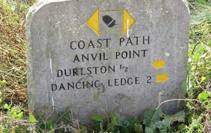 A Busman's holiday. Coast path sign near Durlston © Colin Church