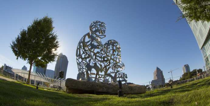 The dedication ceremony Tuesday, September 15, 2015 of Ainsa III, a stainless steel and stone art installation at the UNC Charlotte center city campus made by Spanish artist Jaume Plensa and gifted by Charlotte's own philanthropic group Queen's Table