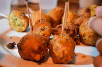 Fried conch fritters - finger foods on stick
