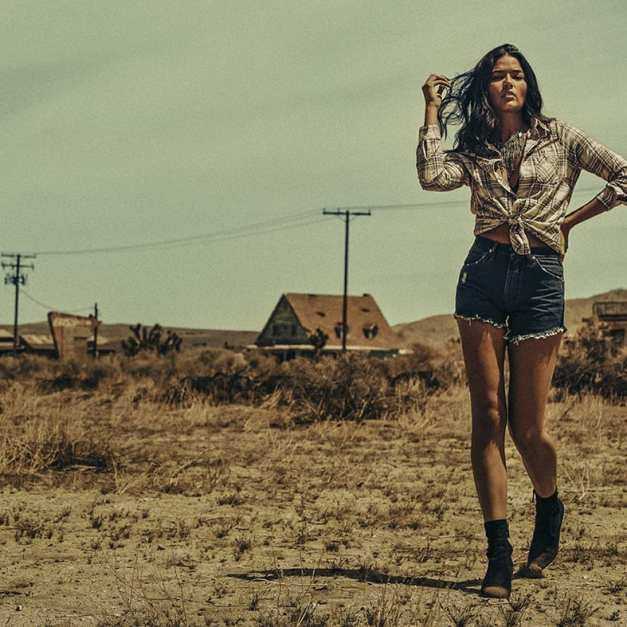 Women's Reworked Cut-Off Denim Short, $69—Wrangler.com; boots, model's own; Shyanne Women's Floral Embroidered Plaid Long Sleeve Shirt, $39.99—Boot Barn.