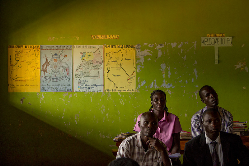 Four Global Leaders Teachers sit in a classroom attending a child safety lesson with some members of the FAF team.