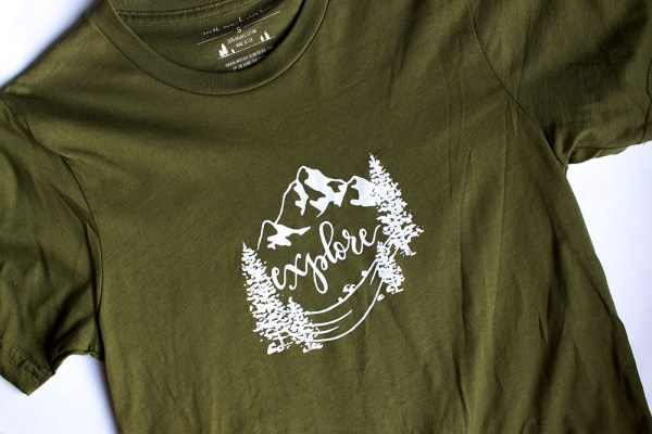Explore trees and mountain design on olive green tshirt