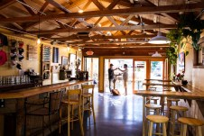 The Stone's Throw taproom offers an abundance of options under exposed wood trusses. Photo courtesy: Stone's Throw Brewery
