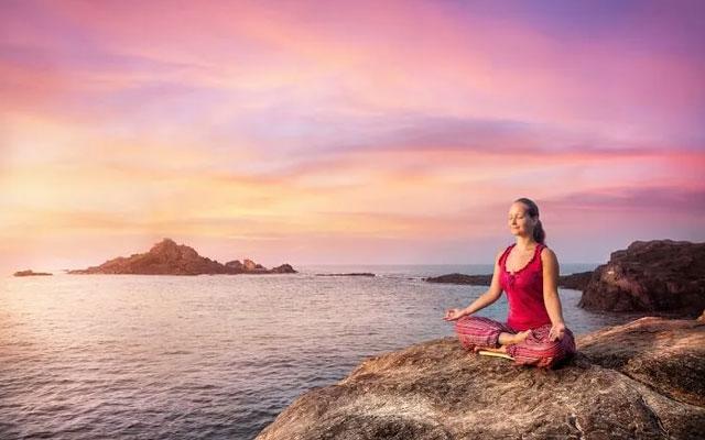 Women practicing Yoga in Gokarna beach