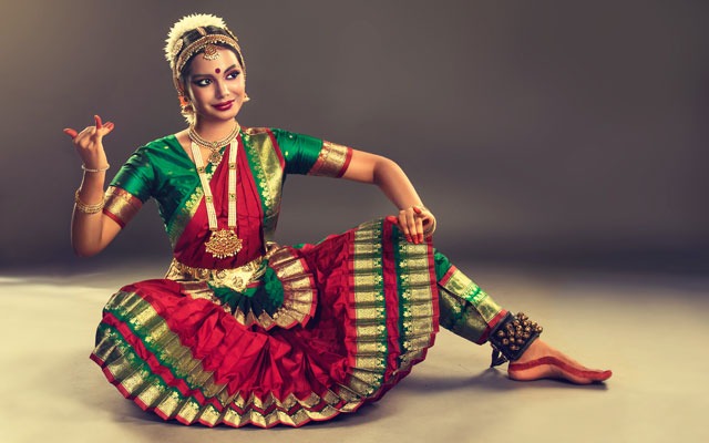 A young girl performing Bharatanatyam dance