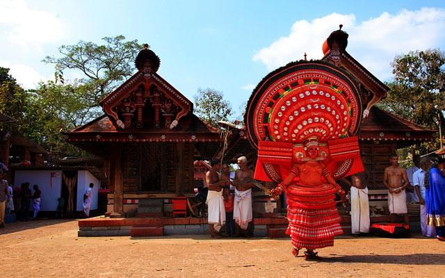 An unidentified Theyyam artist performs at Kadannappalli Muchilot Bhagavati temple in Kannur, India.