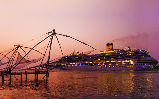 A charming glimpse of Chinese fishing net and a international cruise ship located in Fort Kochi port Kerala.