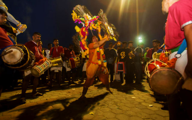 A women dancing on the occasion of Thaipoosam festival with Kavadi