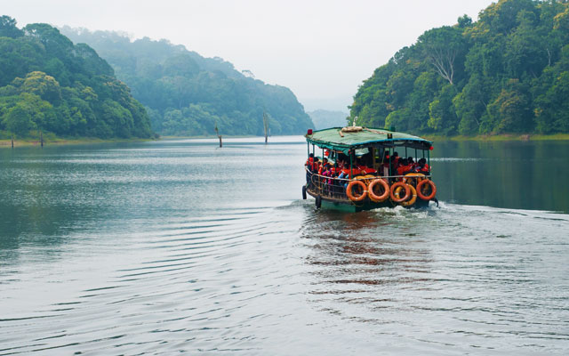 Tourists on board on boat at Periyar Tiger Reserve National Park wildlife sanctuary for sight seeing.