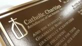Catholic Charities Bronze Precision tooled plaque